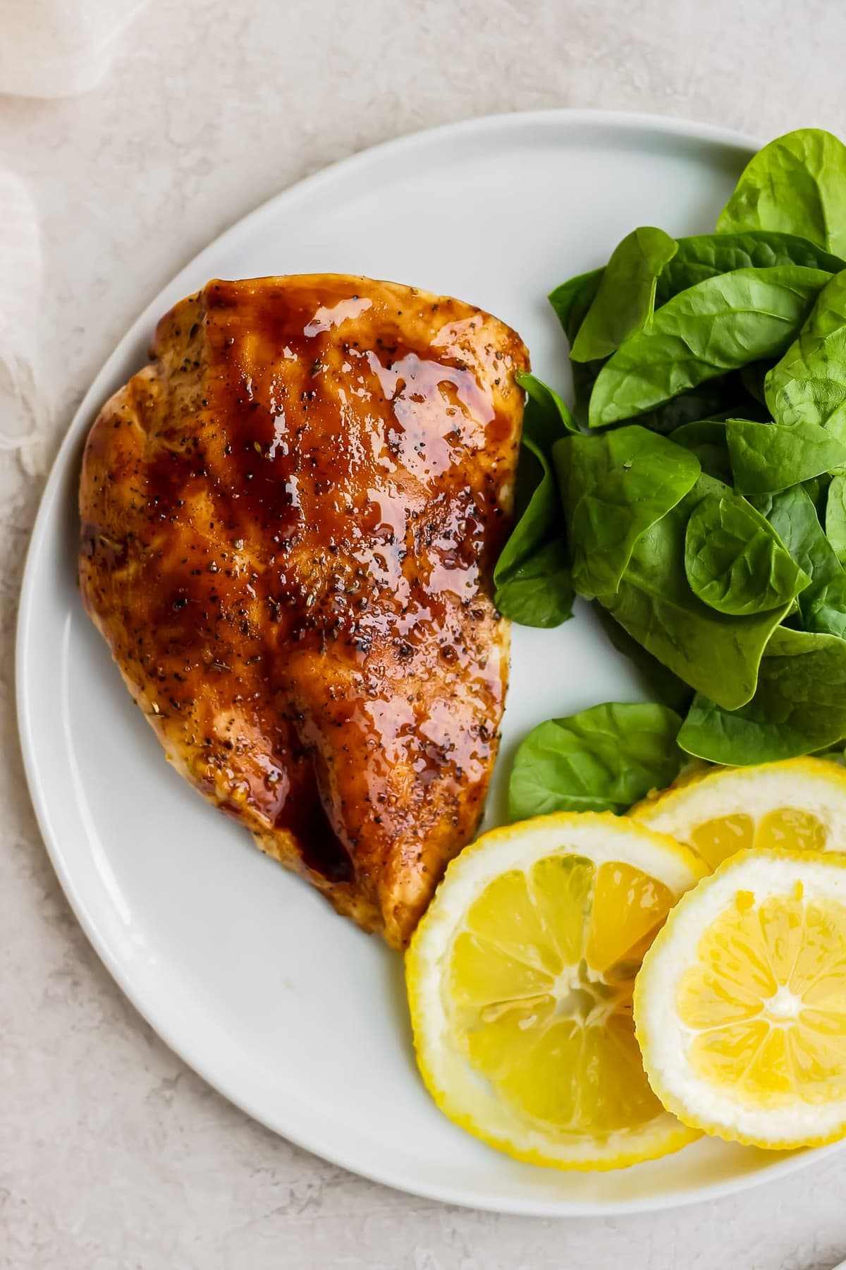 balsamic glazed chicken breast on a plate