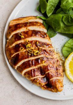 balsamic baked chicken sliced on plate