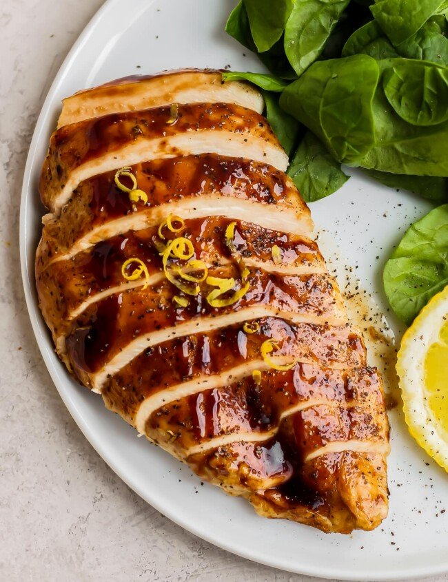 balsamic baked chicken sliced on plate