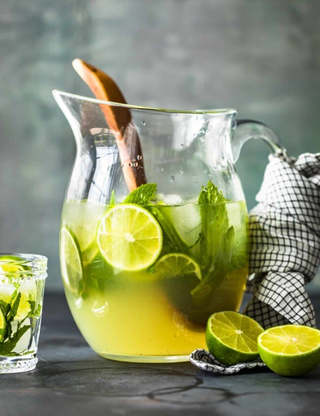 a pitcher of mojitos on a table