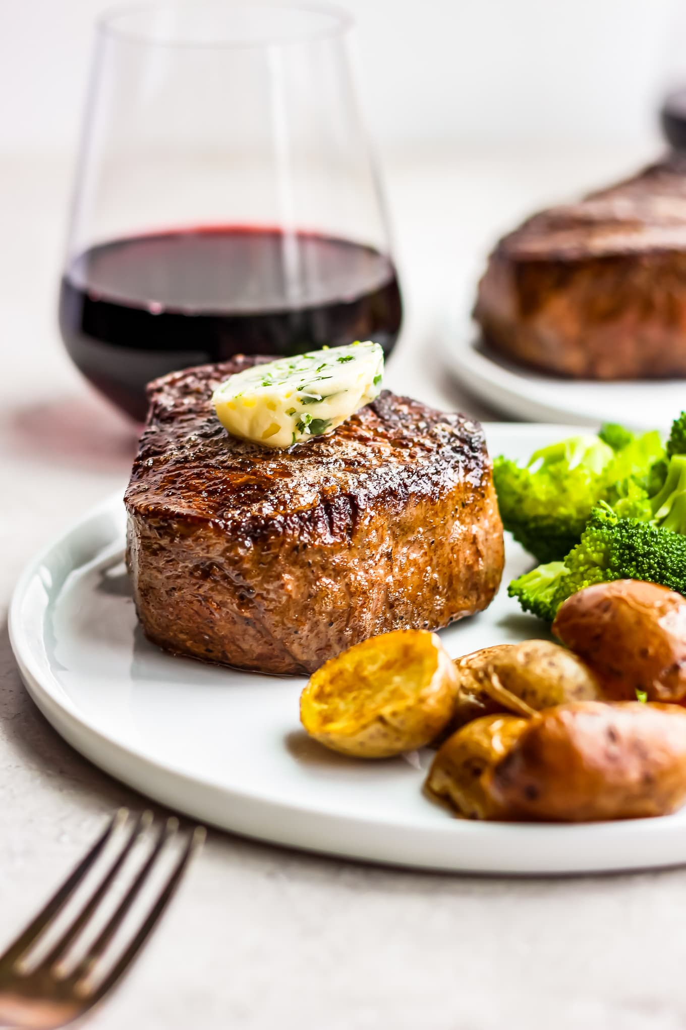 steak dinner with a glass of red wine