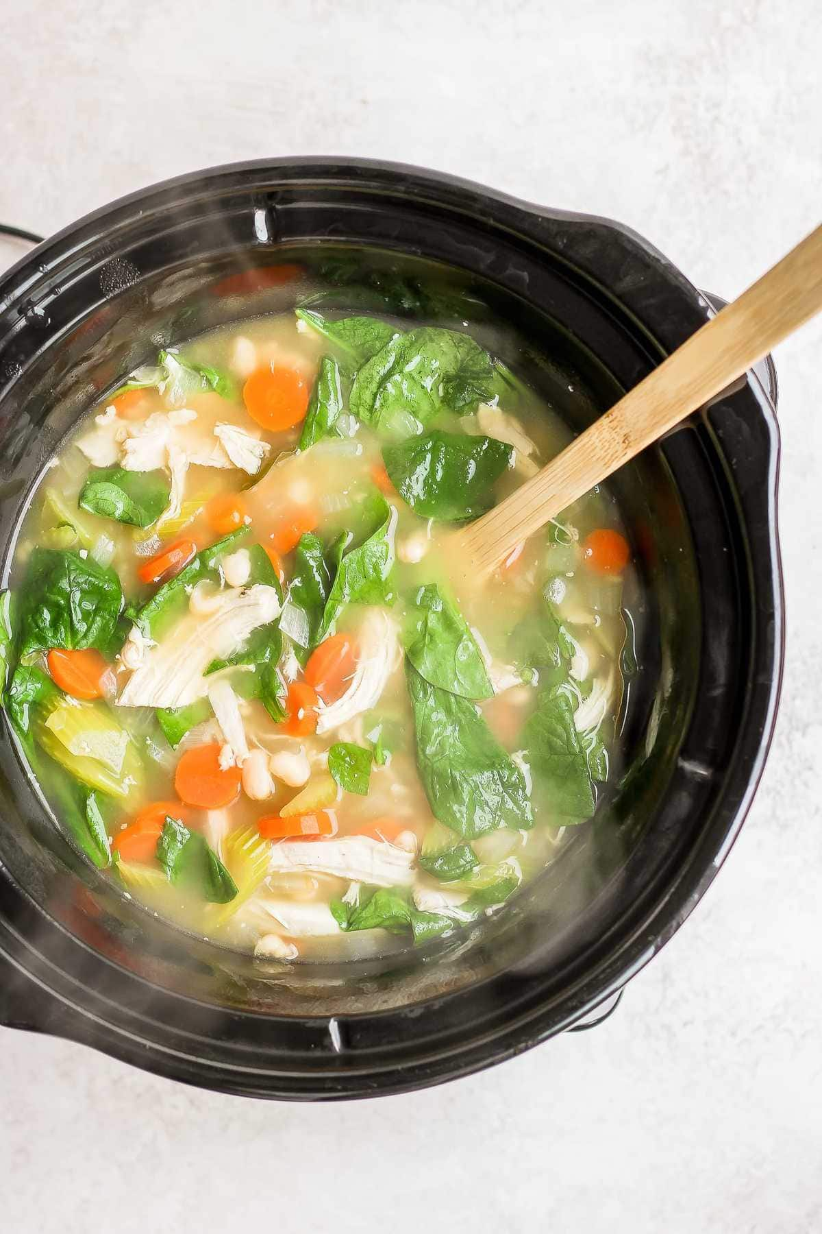 tuscan chicken soup cooking in a crockpot