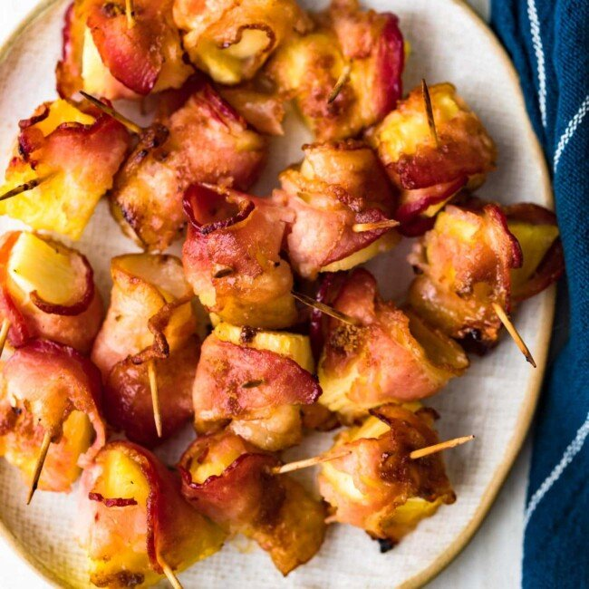 bacon wrapped pineapple on plate