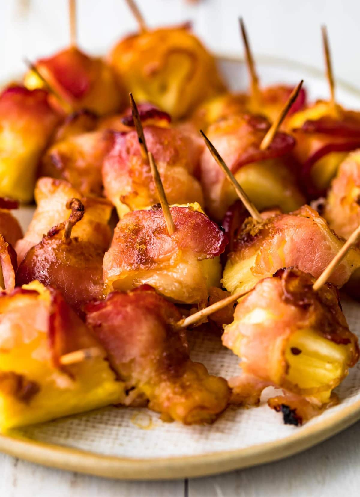 Close up of pineapple chunks wrapped in bacon