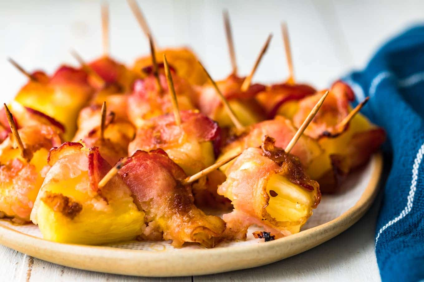 pineapple wrapped in bacon on a serving plate