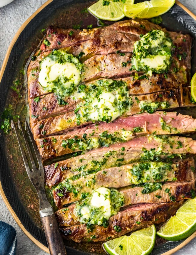grilled flank steak with cilantro lie butter on top