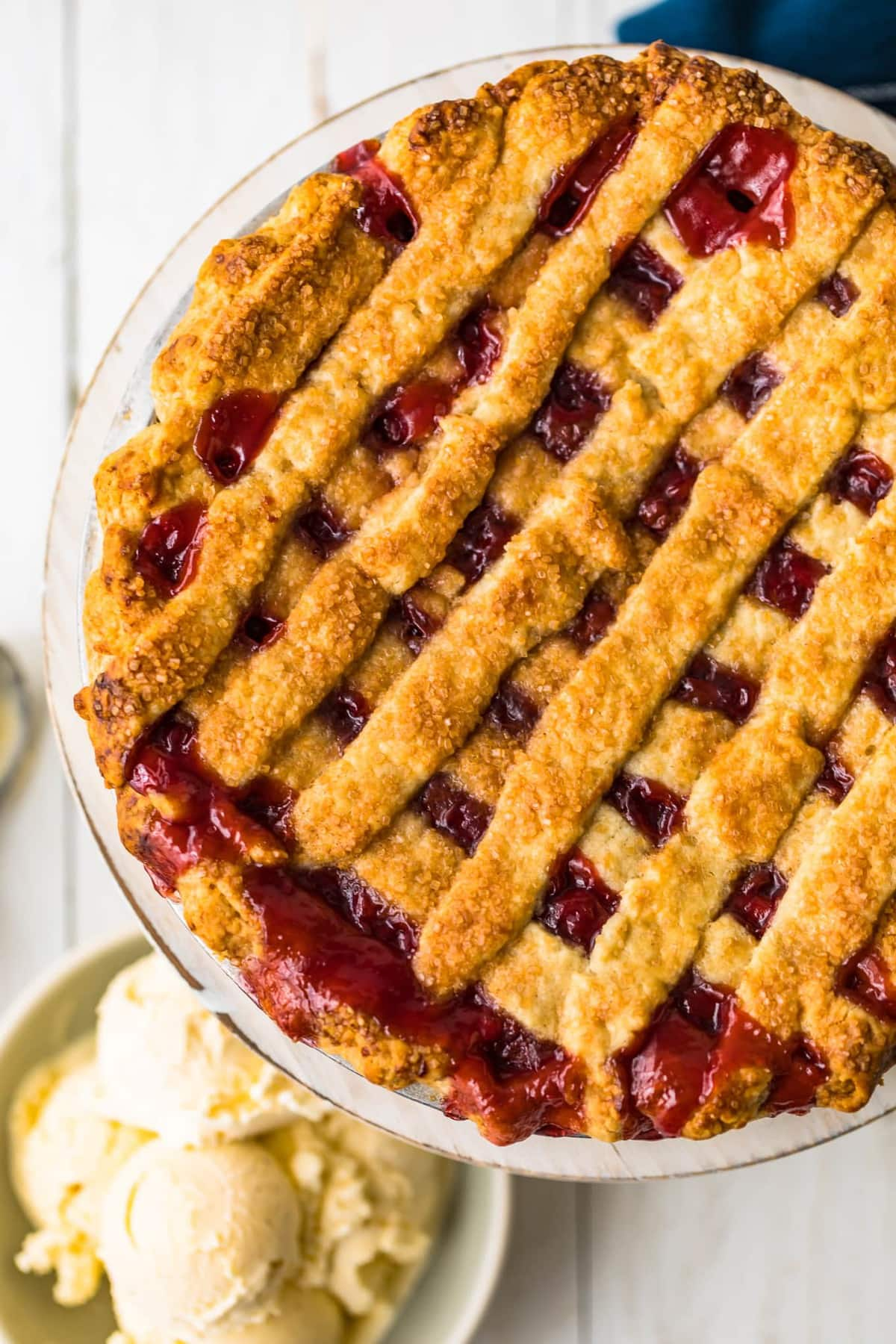 A homemade cherry pie with a lattice top