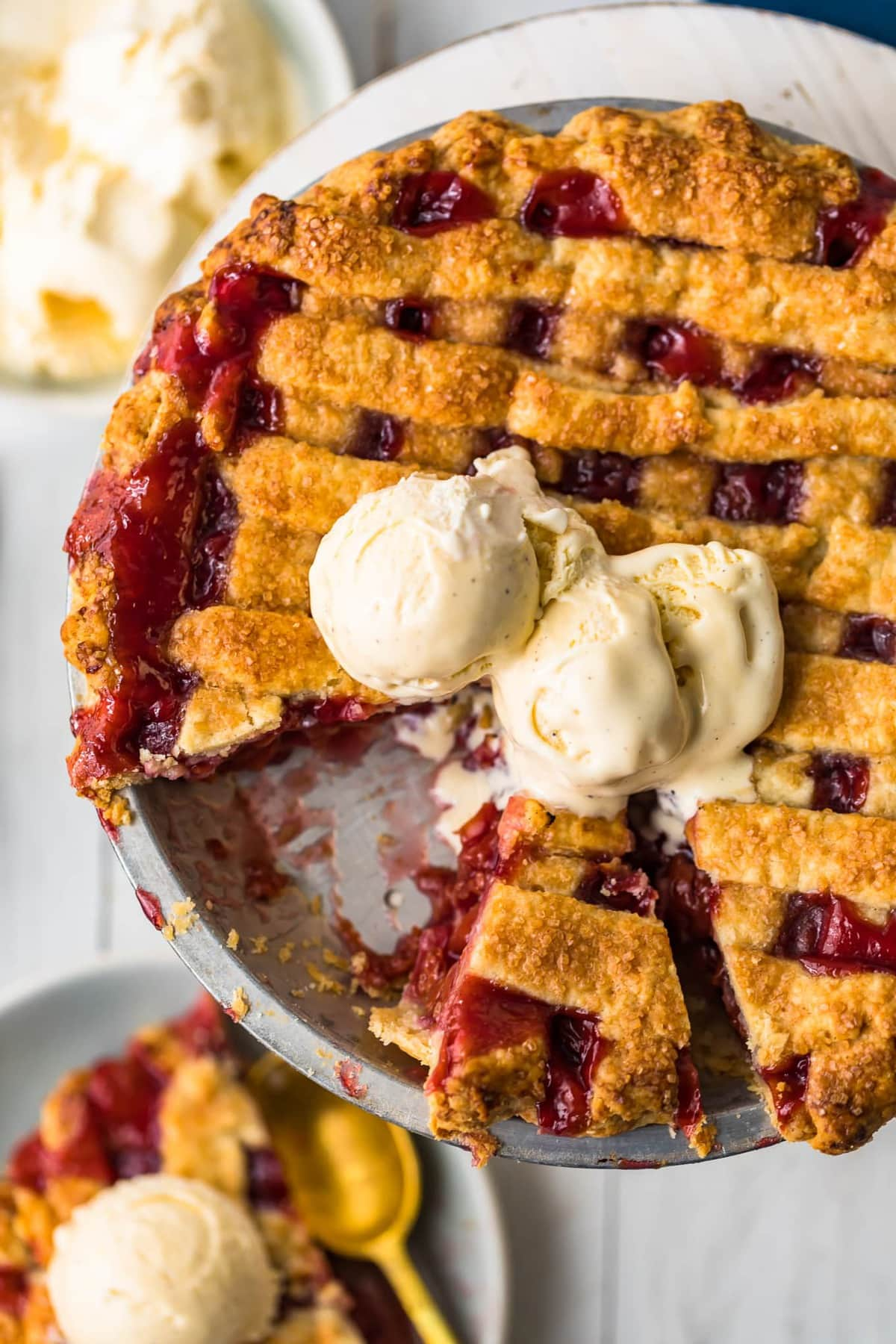 A homemade cherry pie with two scoops of ice cream