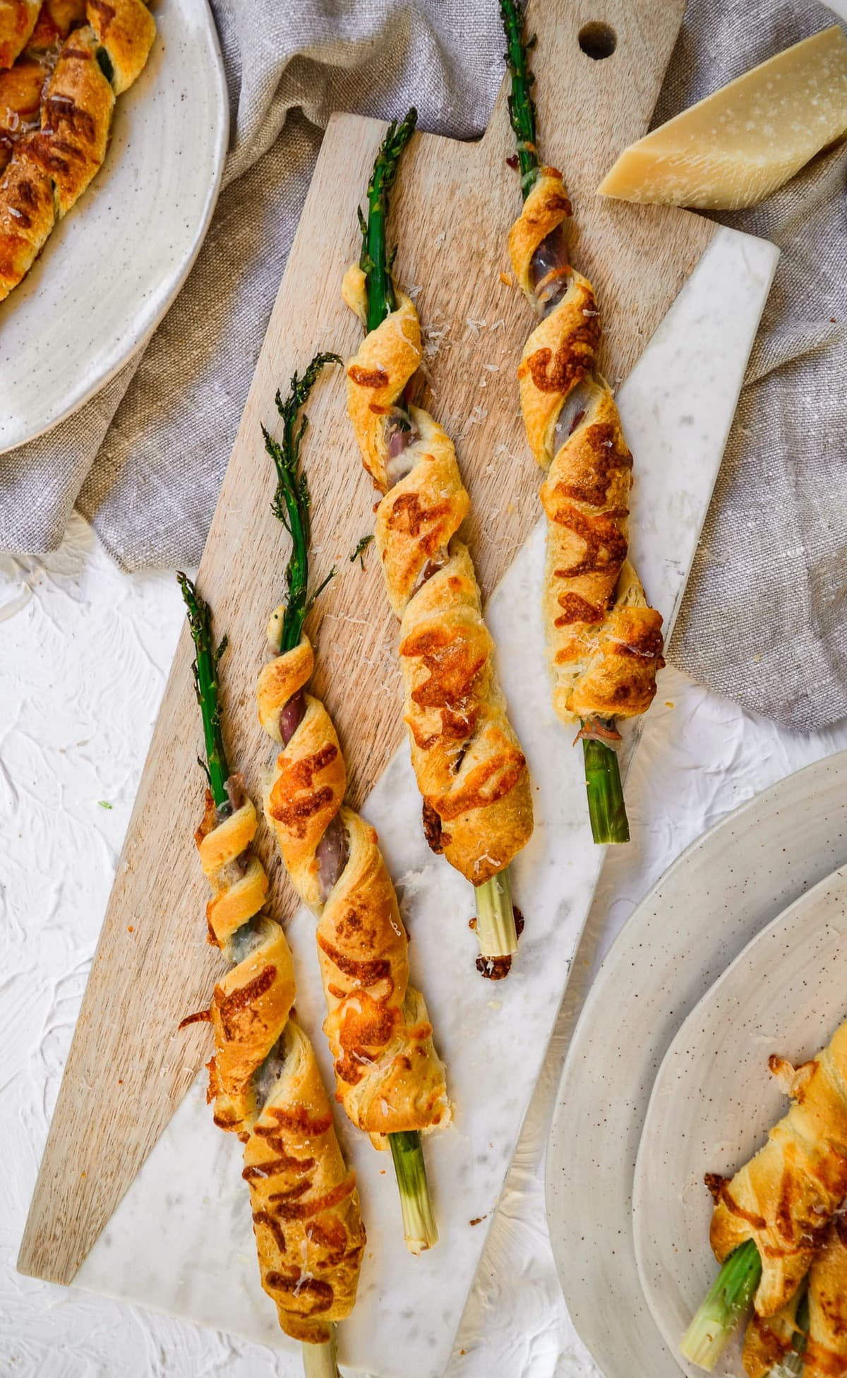 asparagus crescent rolls on a serving board