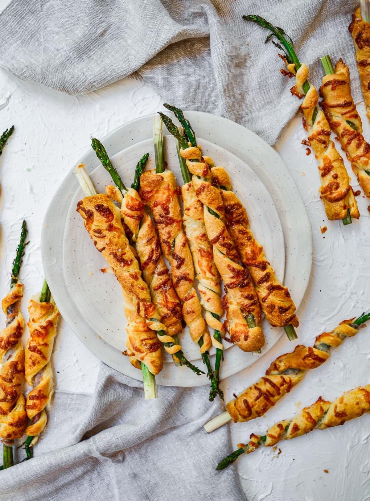 a plate of asparagus crescent roll spirals