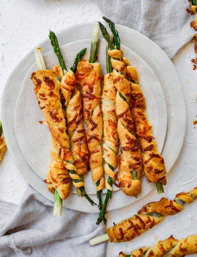 asparagus wrapped in puff pastry on white plate
