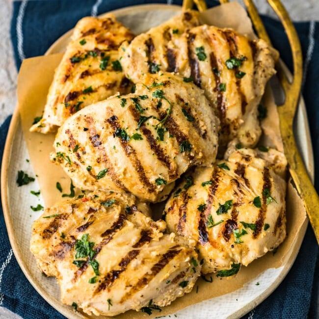 grilled yogurt marinated chicken thighs on platter