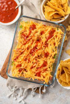 taco dip in a baking dish