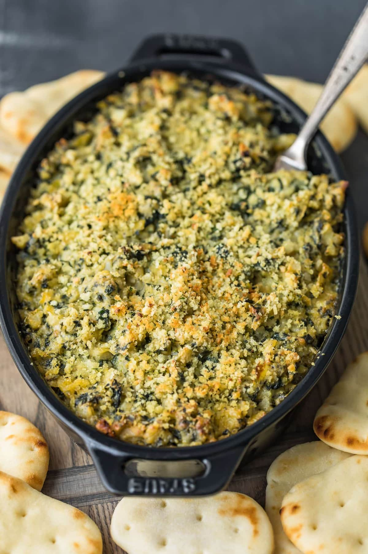 Baked Spinach Artichoke Dip with a fork in it
