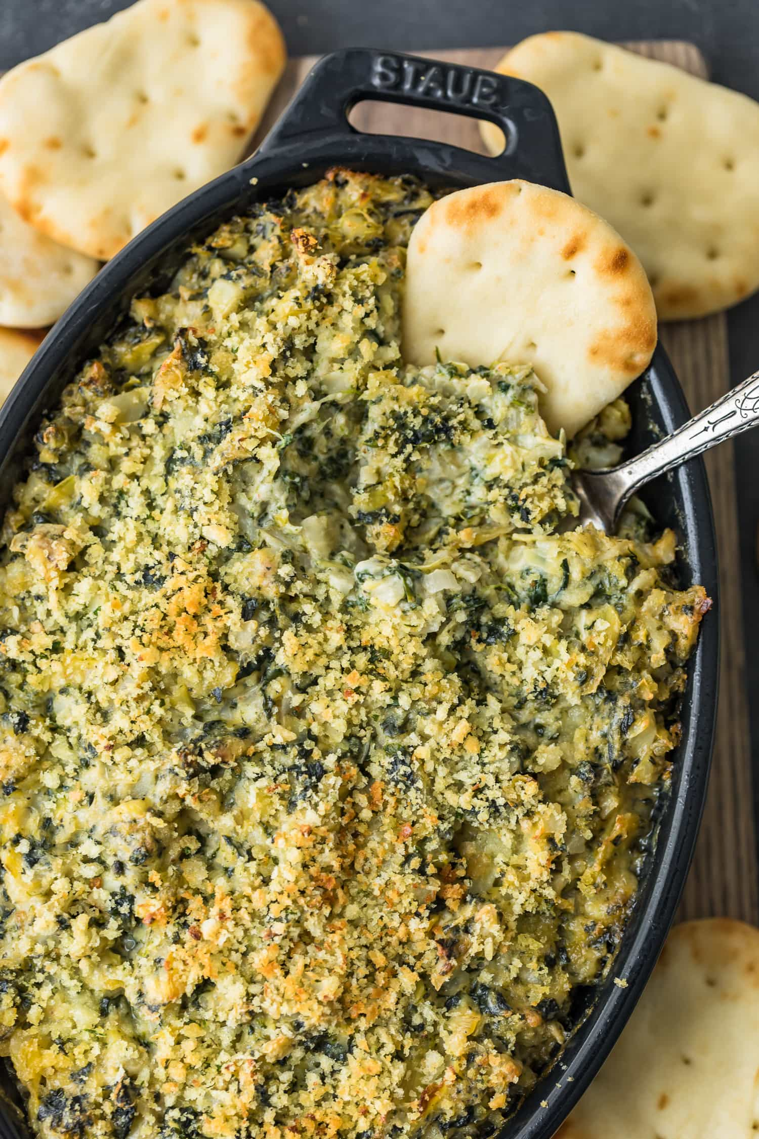 Baked Spinach Artichoke Dip served in a black dish