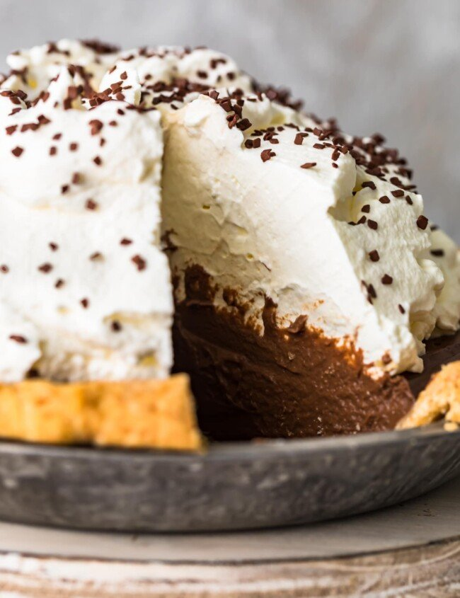 creamy chocolate pie with a ton of whipped cream on top