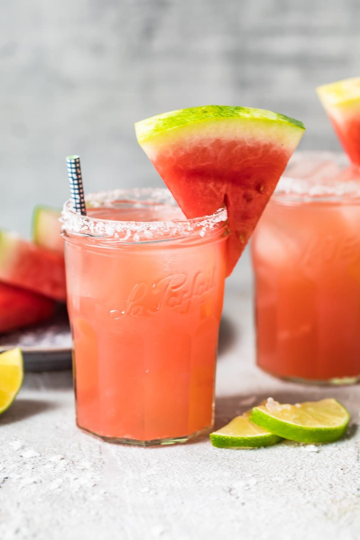 watermelon margarita recipe in glasses with watermelon triangles