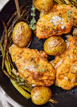 baked chicken and potatoes in skillet