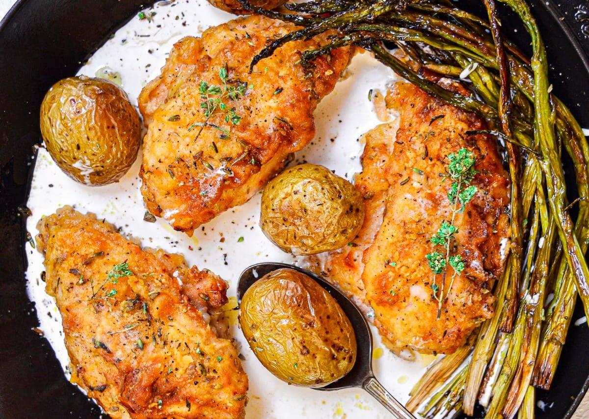 creamy butter baked chicken with potatoes and asparagus
