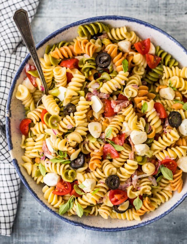 italian pasta salad in a bowl with a spoon