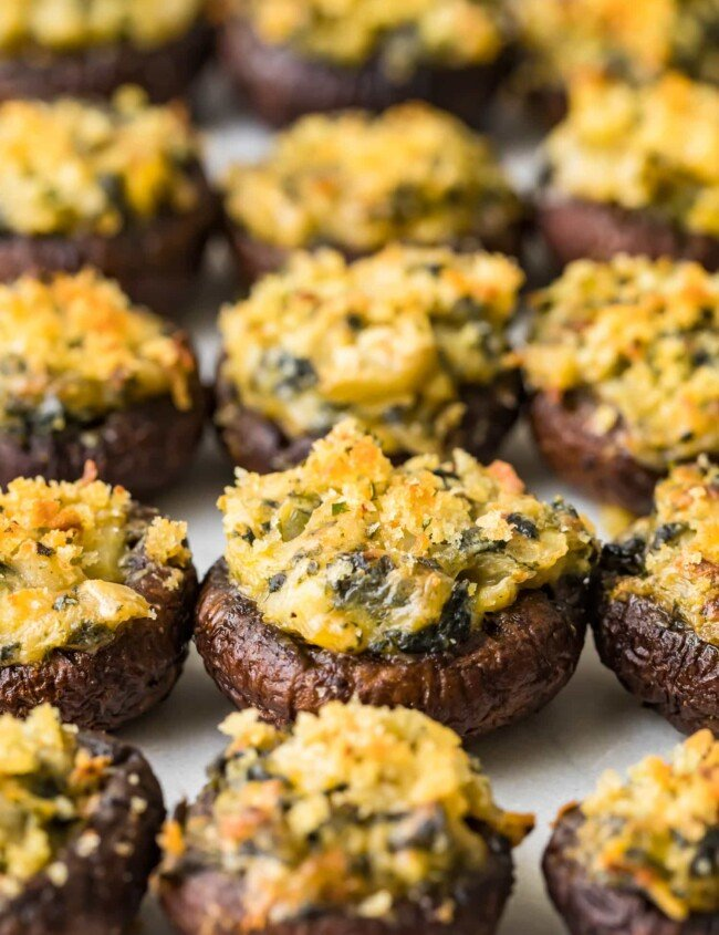 stuffed mushrooms lined up on a sheet
