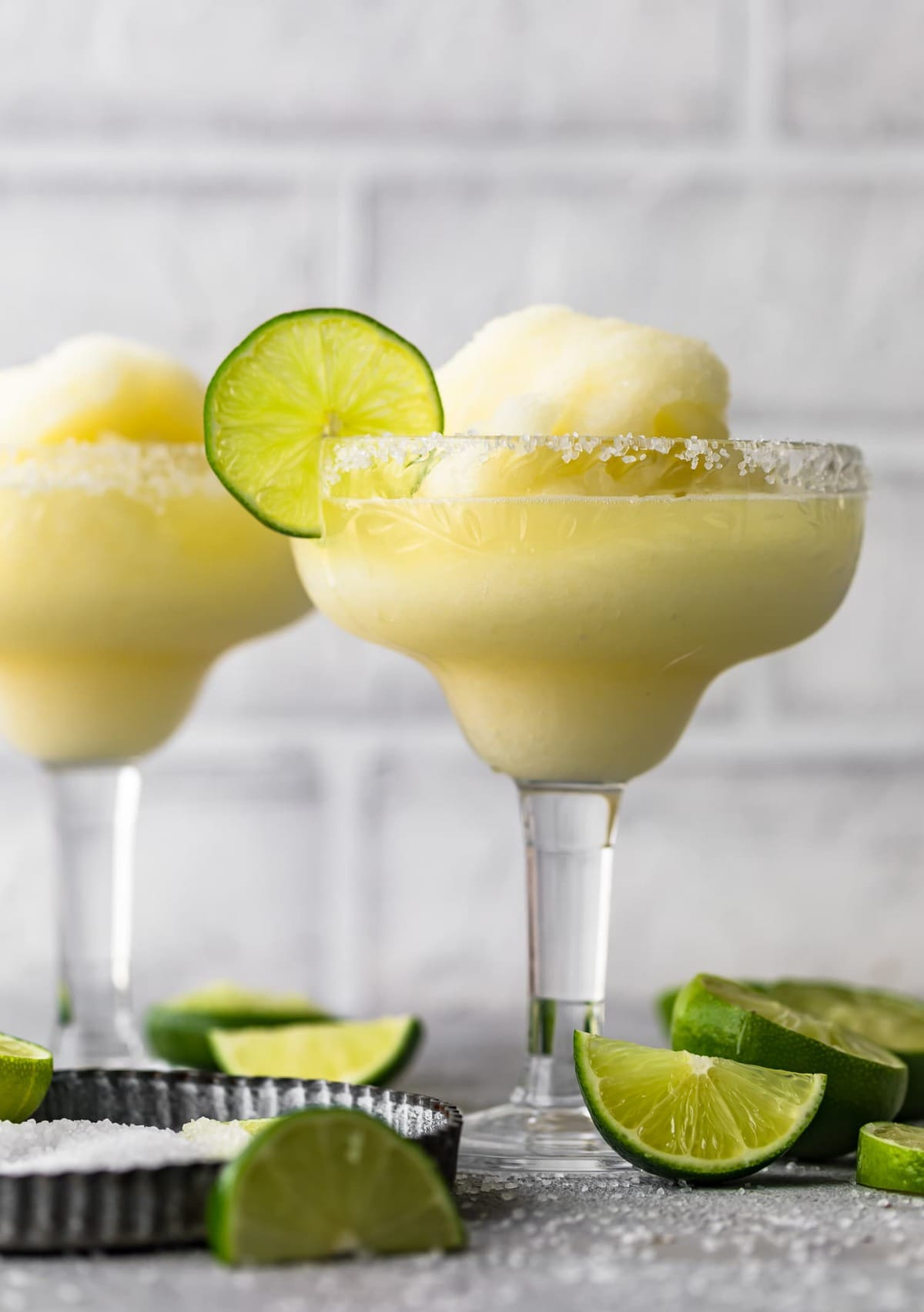 Two frozen margaritas served in glasses