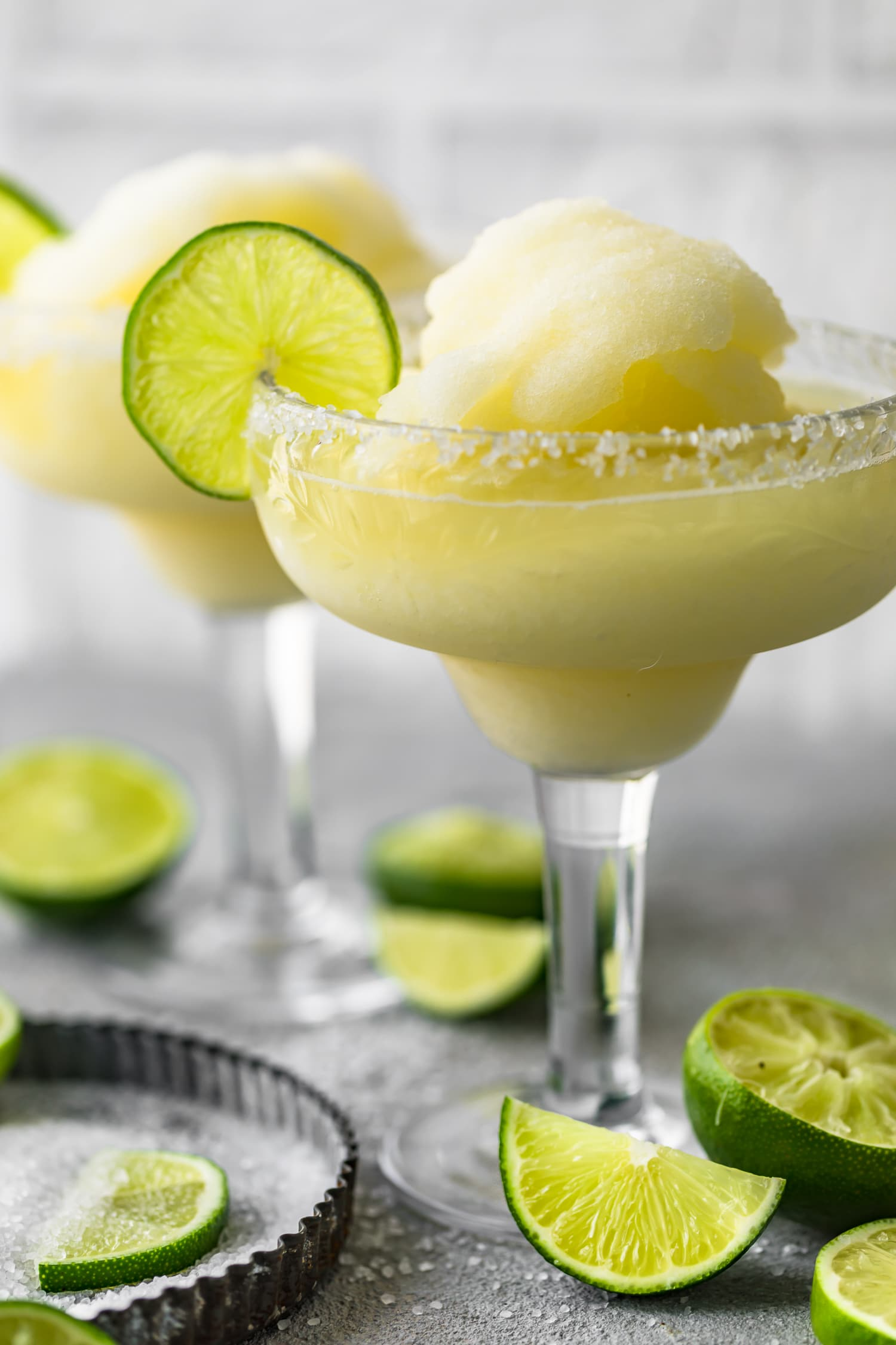 A frozen margarita in a salt rimmed glass