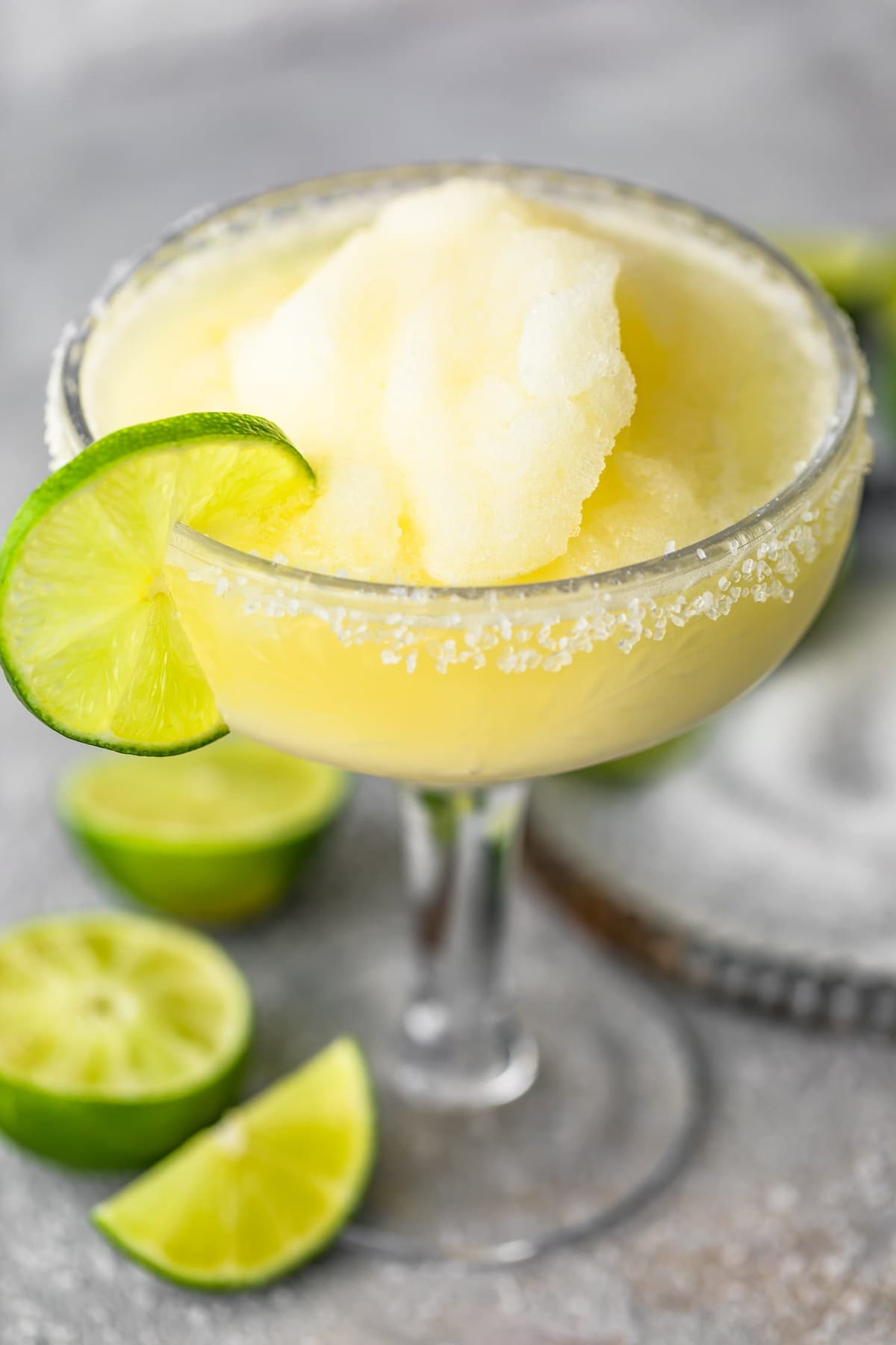 A margarita served in a glass with lime and salt