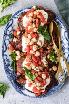 grilled caprese bruschetta chicken on a plate