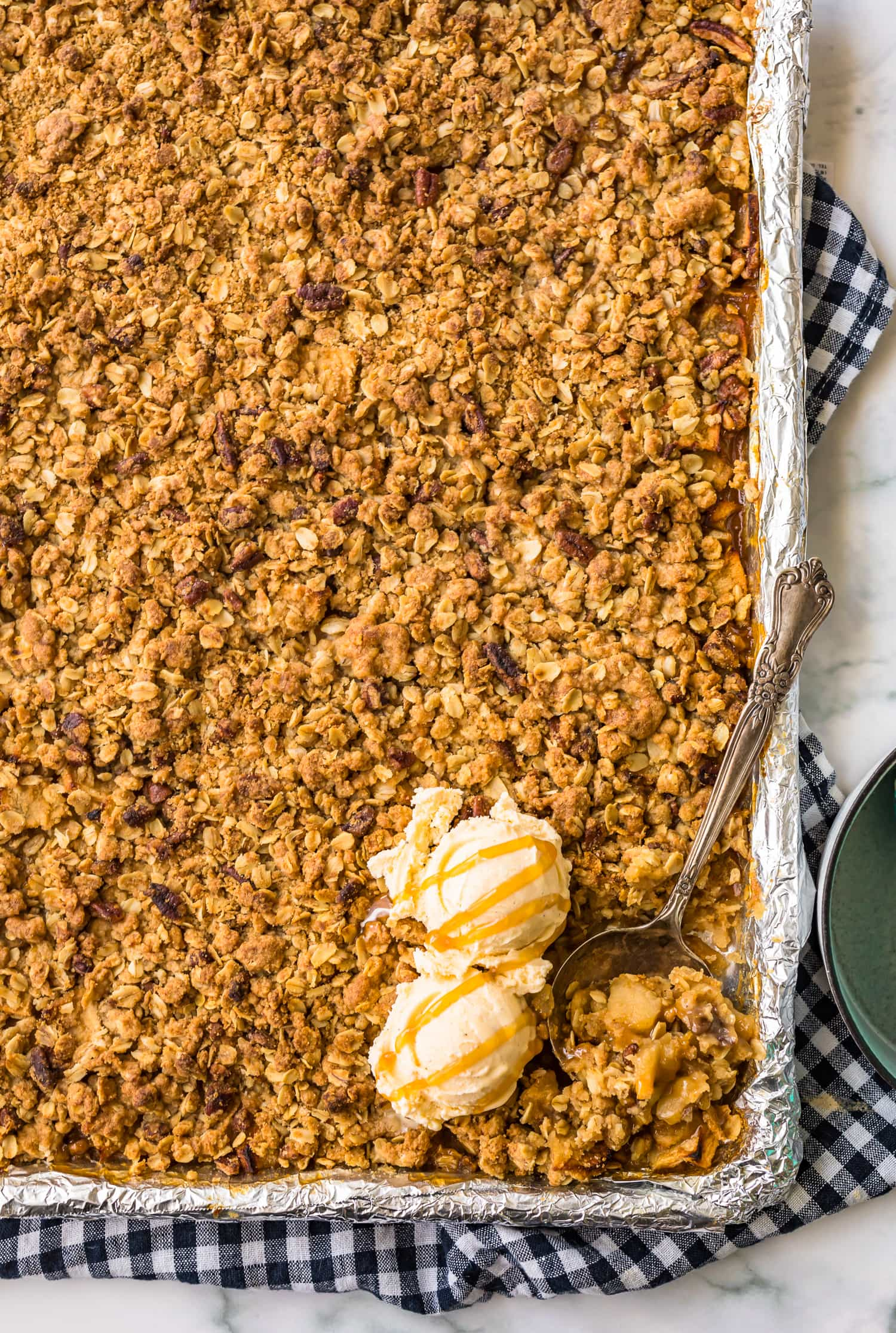 A sheet pan apple crisp with two scoops of ice cream