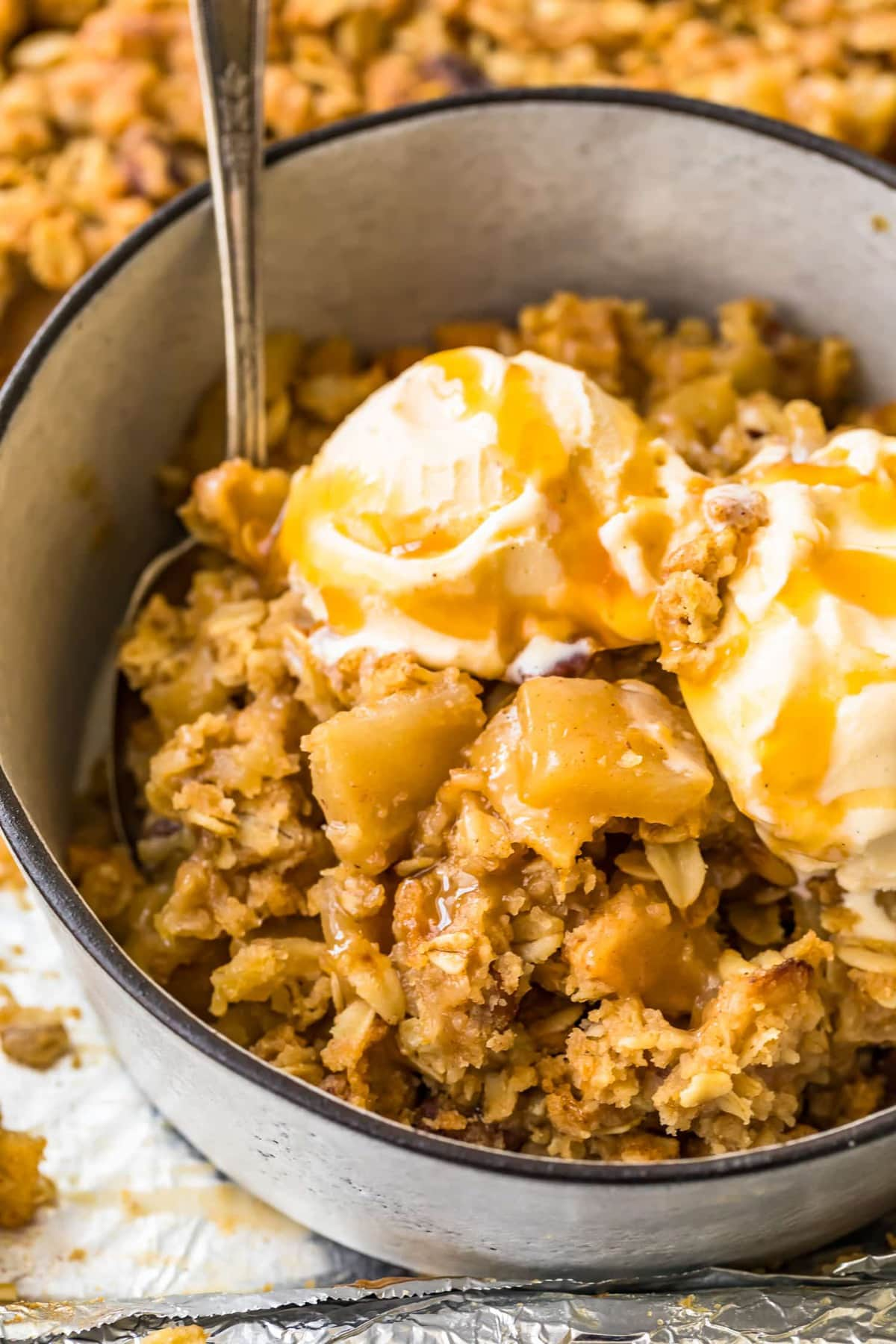 Close up of sheet pan apple crisp and ice cream in a bowl