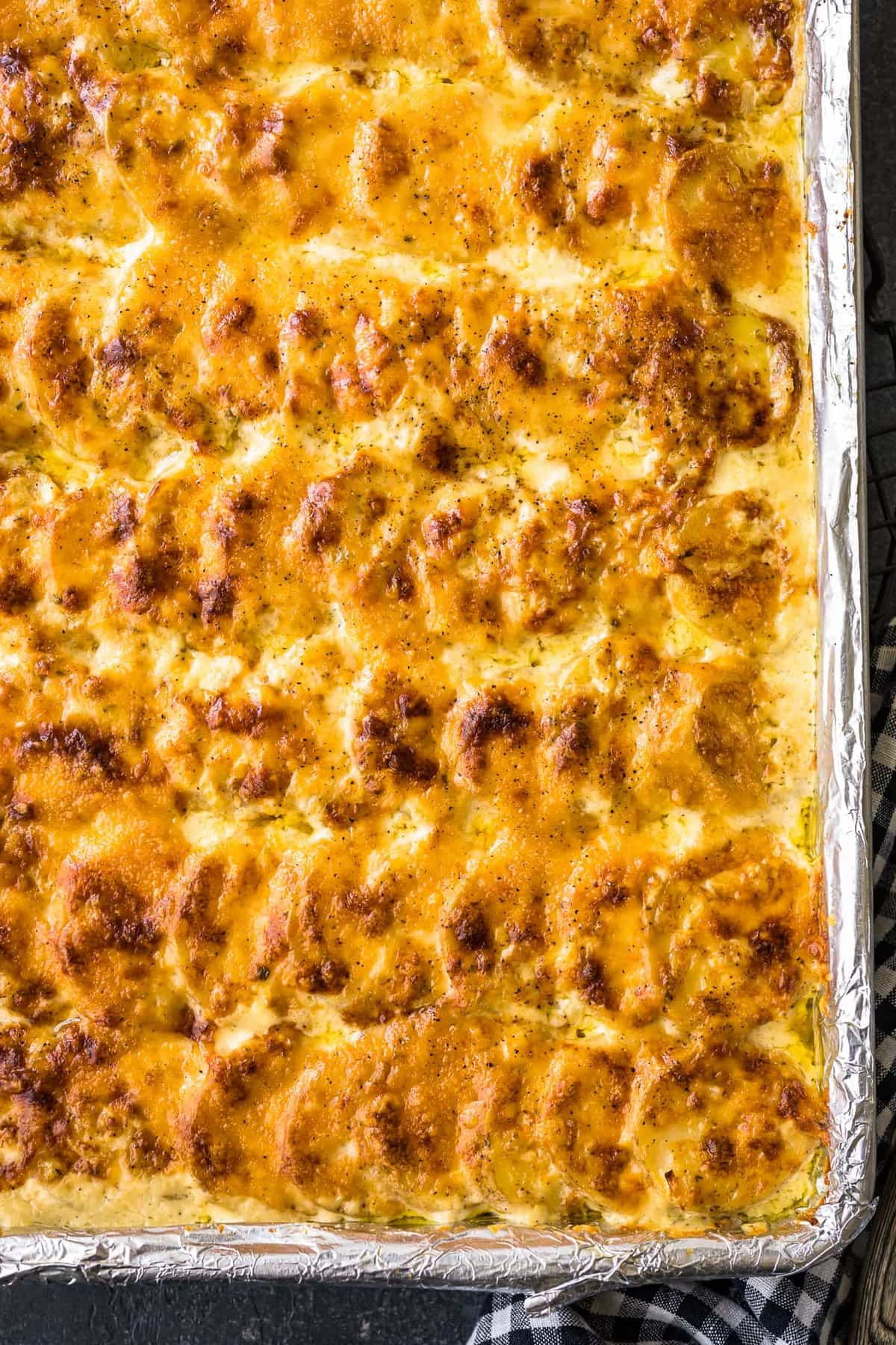 scalloped potatoes baked in a sheet pan