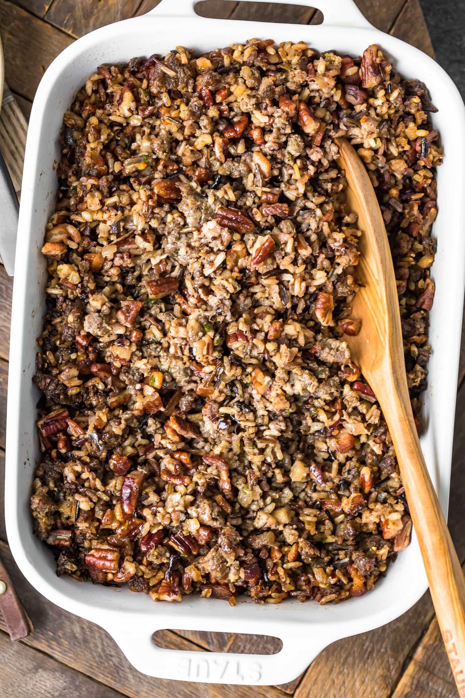Wild Rice Sausage Stuffing in a white casserole dish