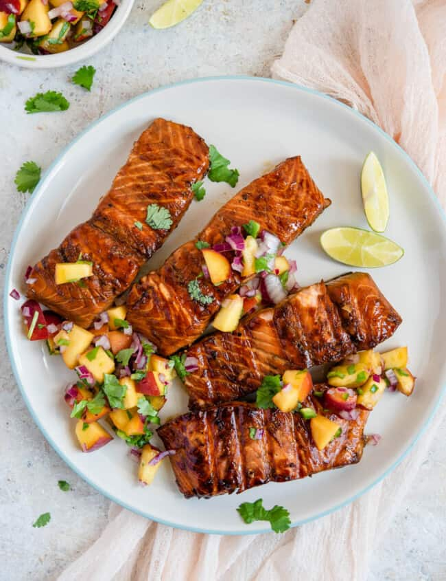 A plate of food on a table, with Salmon and Salsa