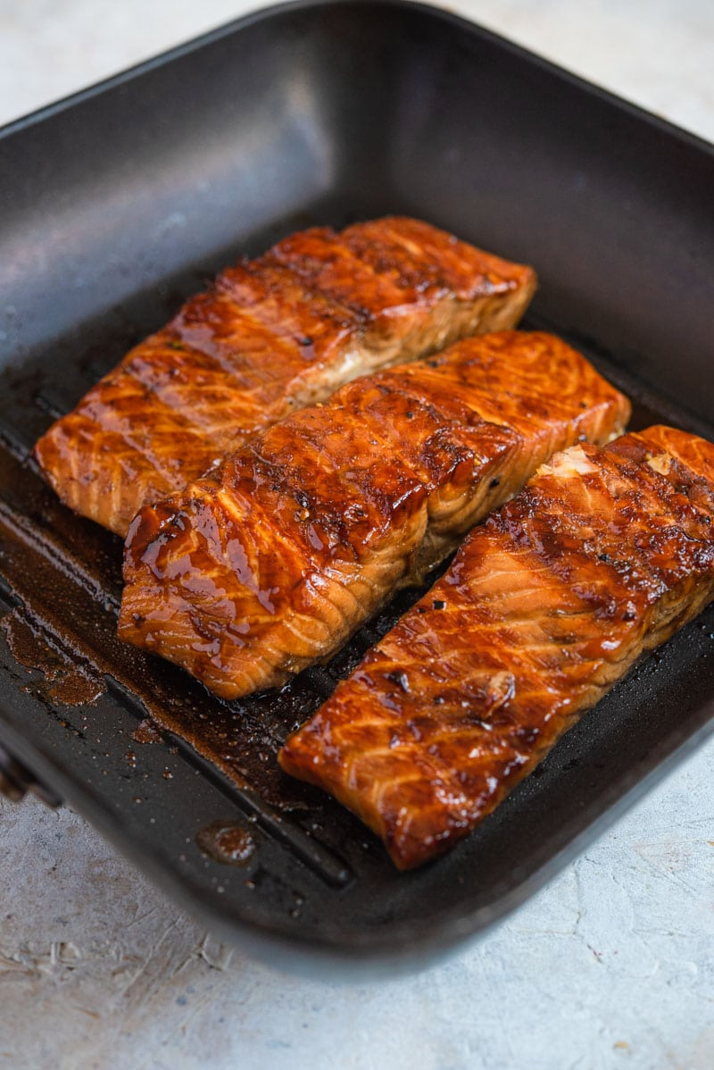 Grilled salmon fillets cooking on a grill