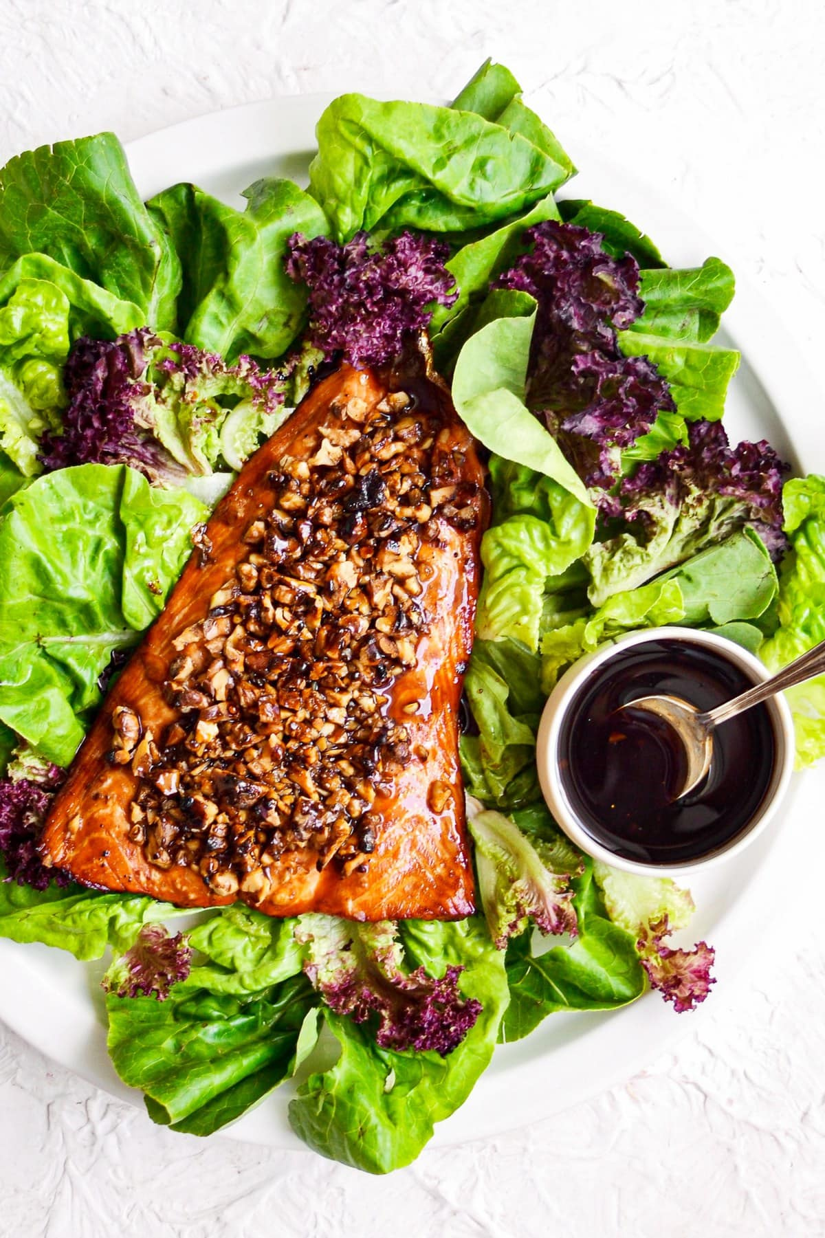 overhead shot of bourbon salmon with salad