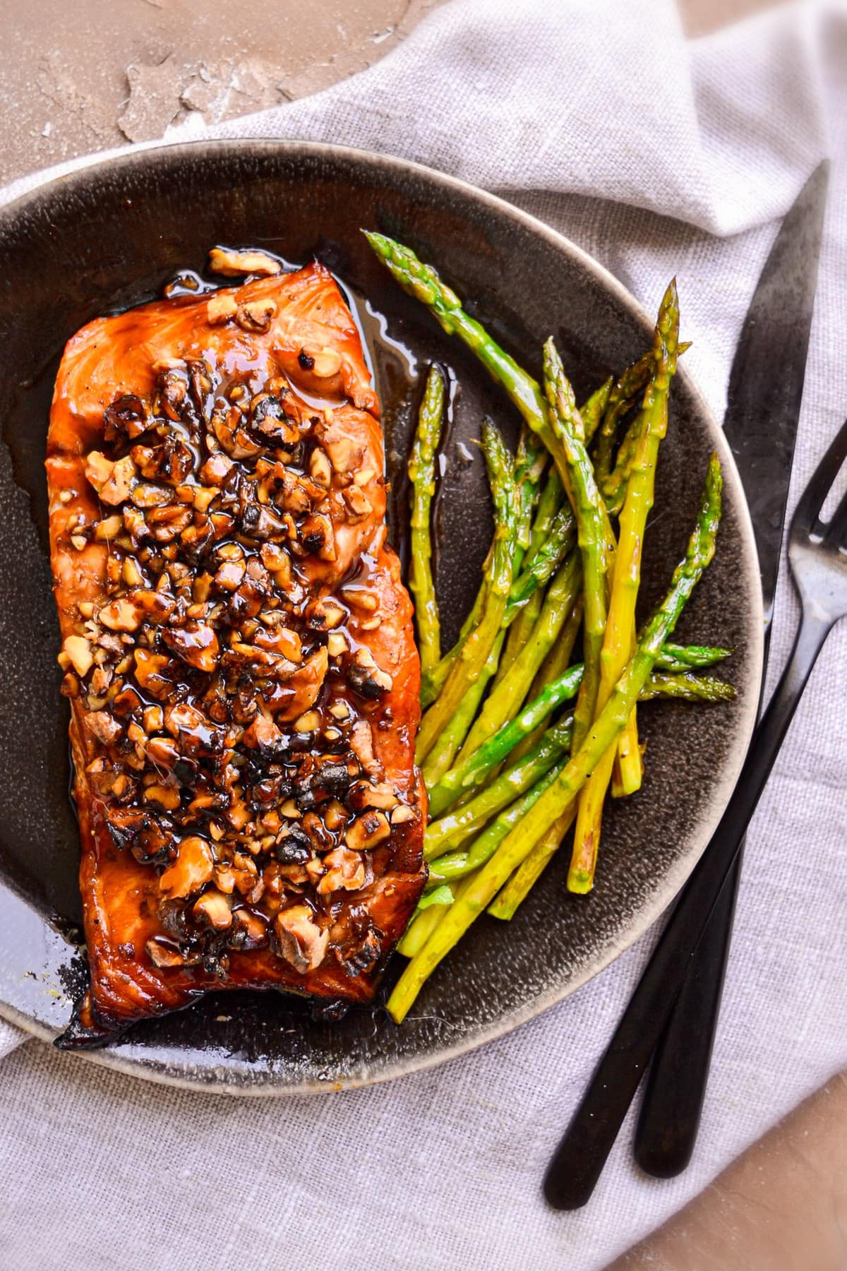 bourbon salmon on plate with asparagus