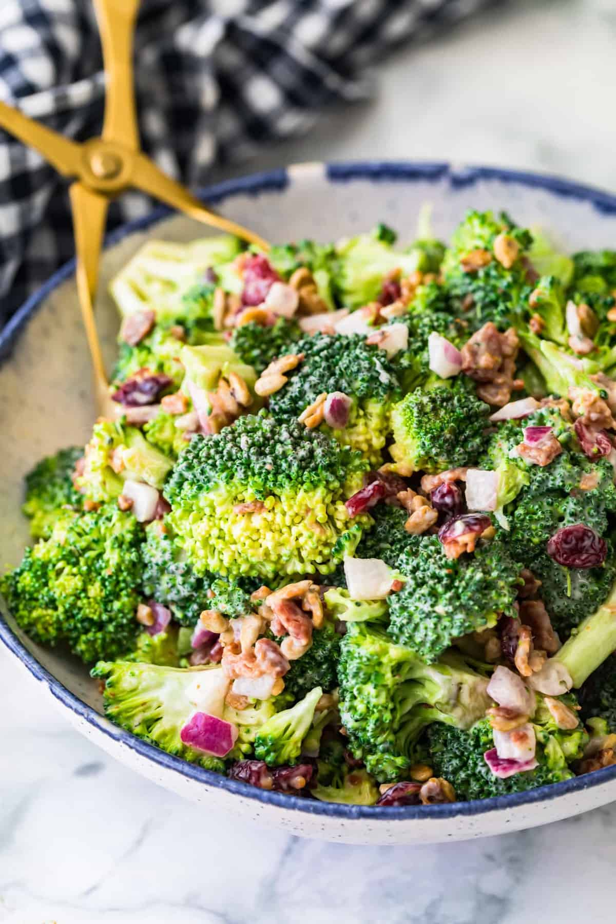 Close up of Broccoli salad in a blue and white bowl
