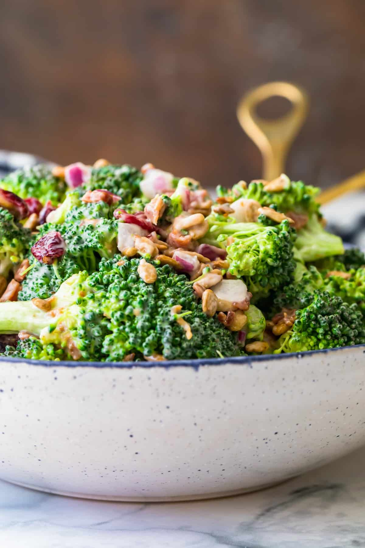 Broccoli salad ready to serve in a large bowl