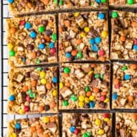 candy bar rice crispy treats cut into squares on cooling rack
