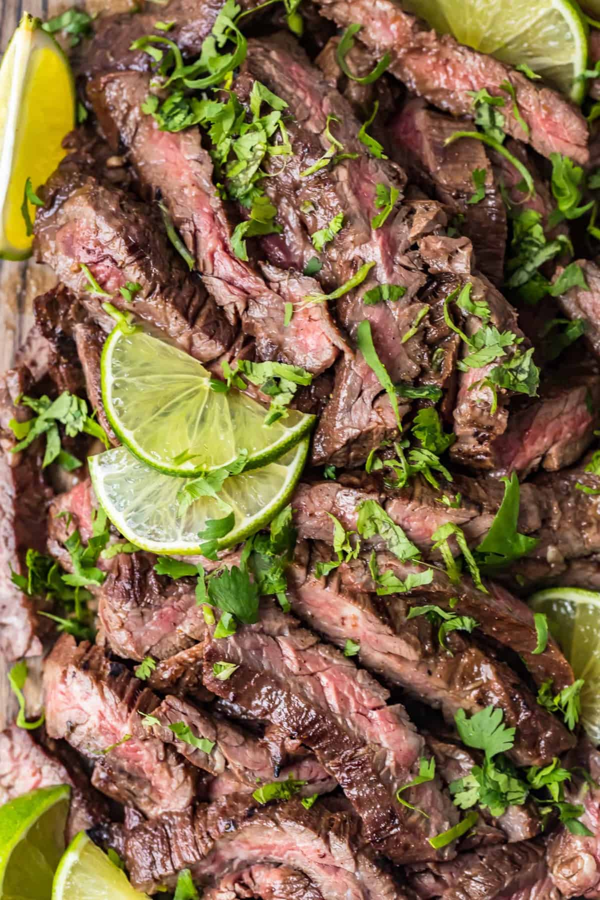 Close up of Carne Asada Steak with lime slices