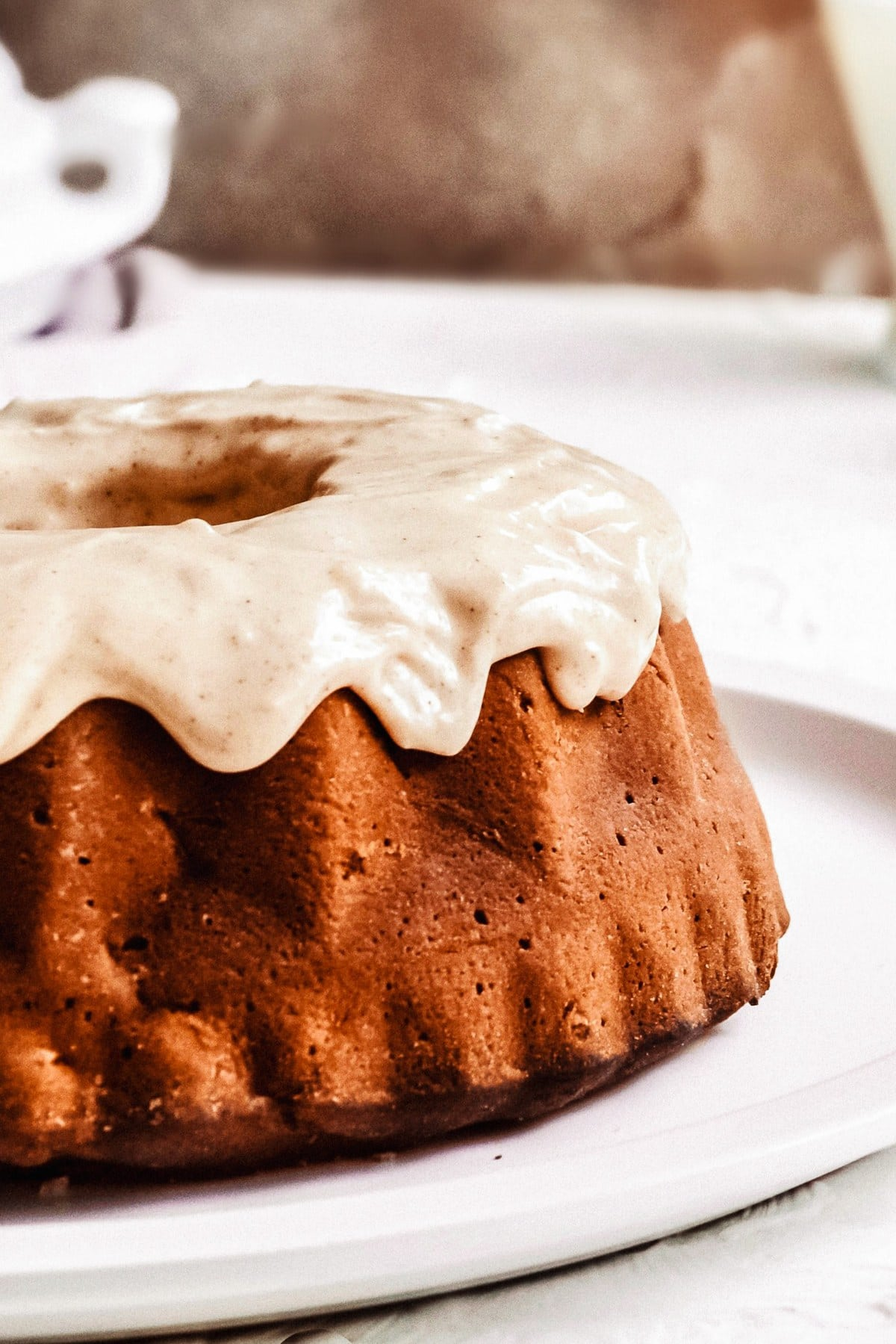 Chunky Apple Bundt Cake with cinnamon-cream cheese icing.