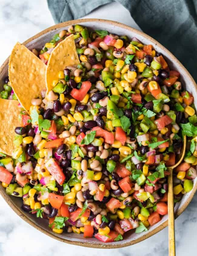 cowboy caviar in pan with chips