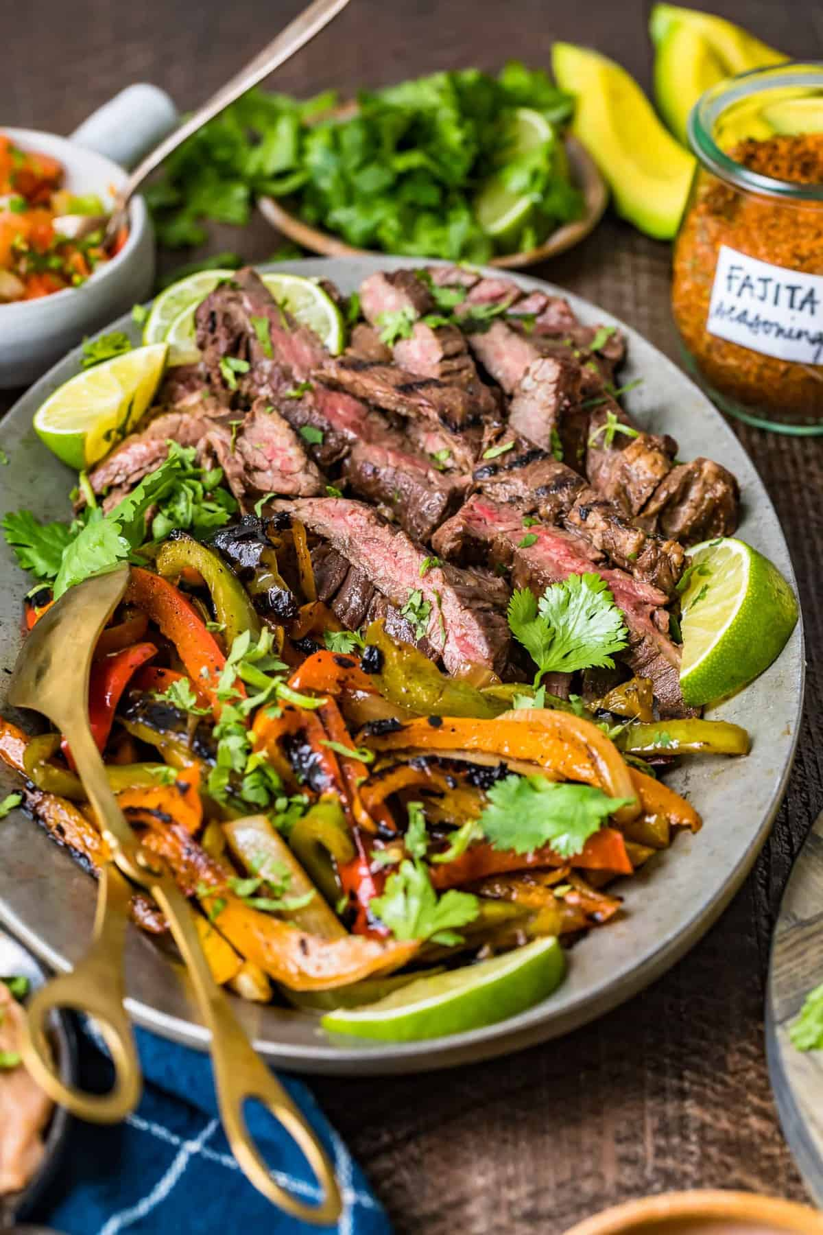 fajita steak and vegetables on a serving plate