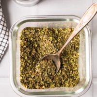 homemade italian seasoning in a jar with spoon