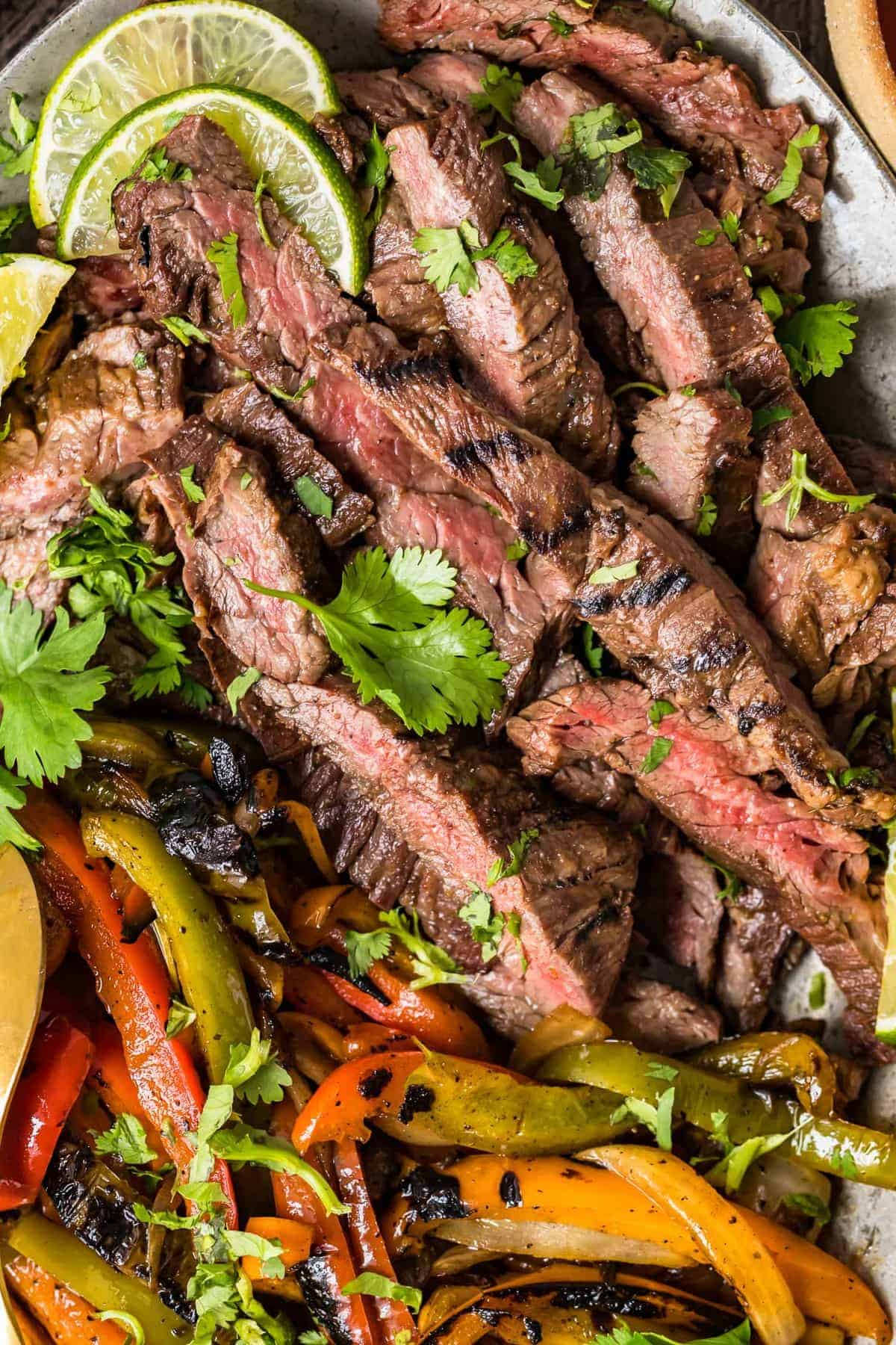 Close up of grilled steak and vegetables on a serving platter