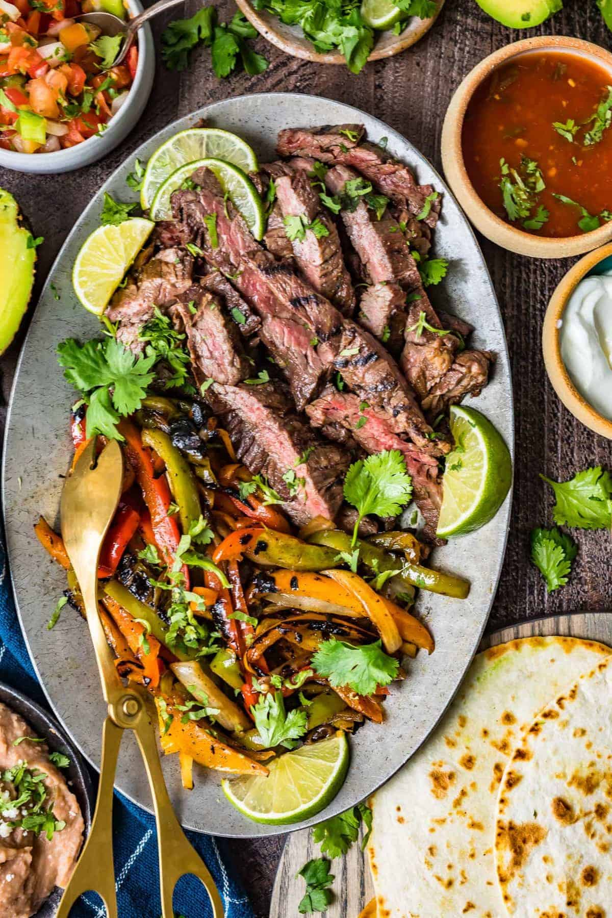 Top down shot of the steak fajitas on a serving plate