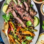 sliced steak and vegetables on a plate