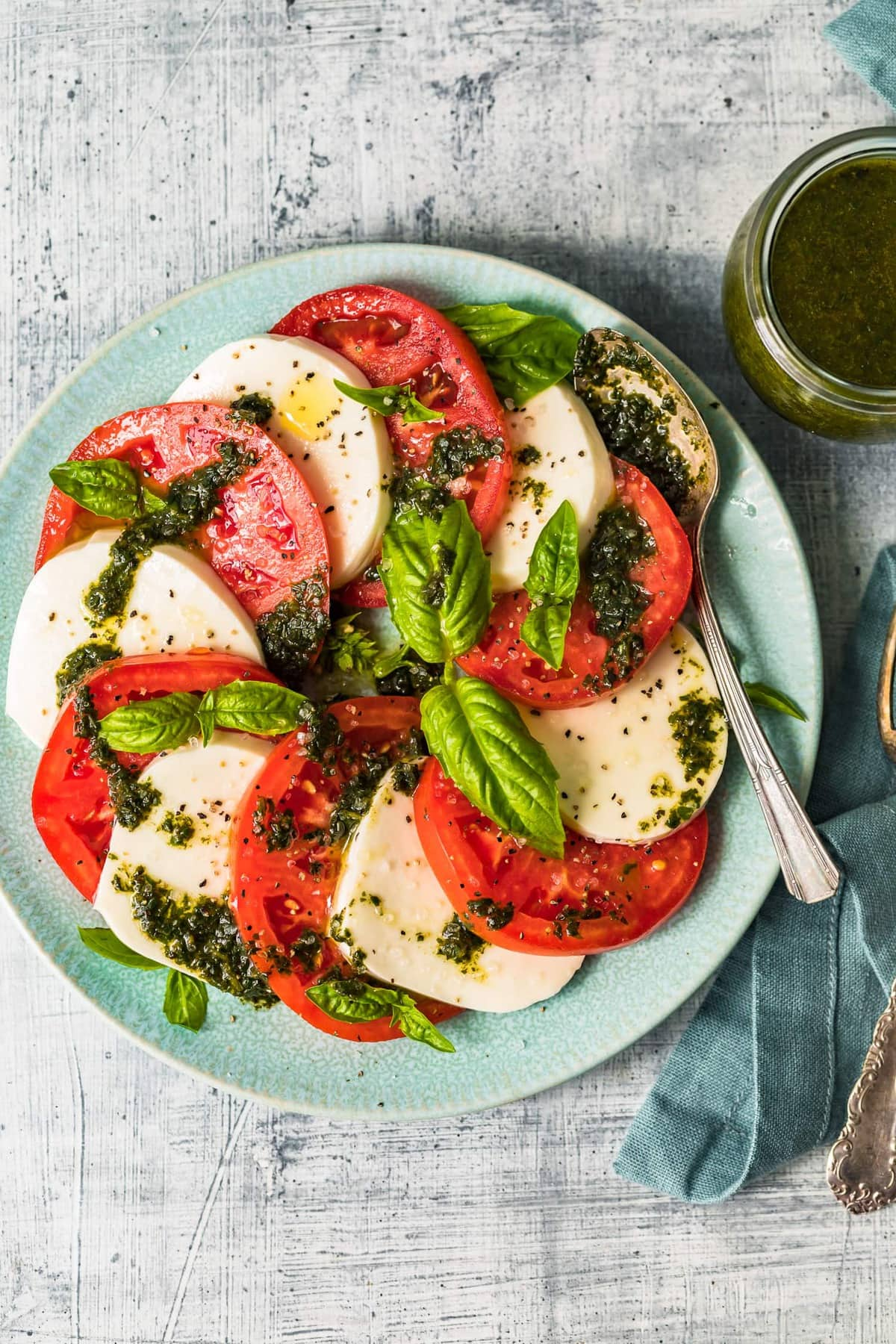 The best caprese salad served on a light blue plate