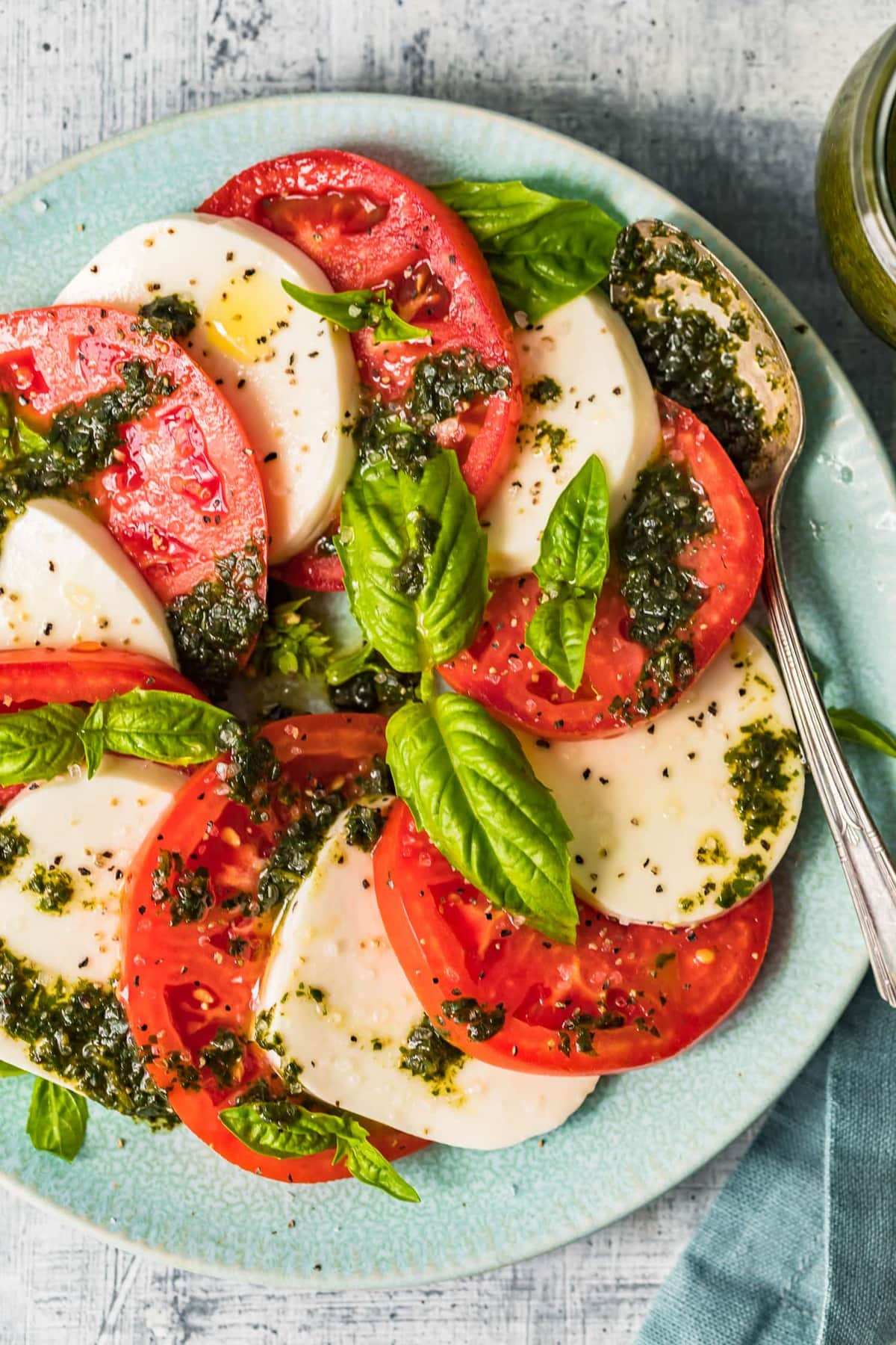 Top down shot of caprese salad with dressing